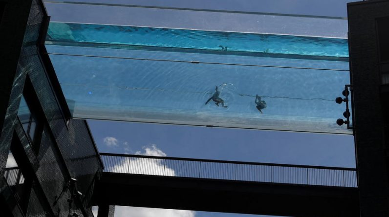 A swimming pool suspended between two buildings has opened in London