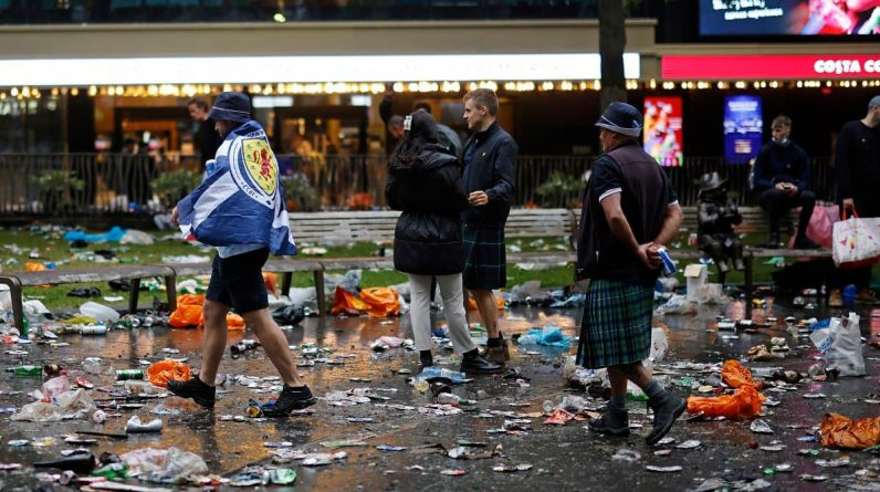 Scottish fans clean up after a big party in London