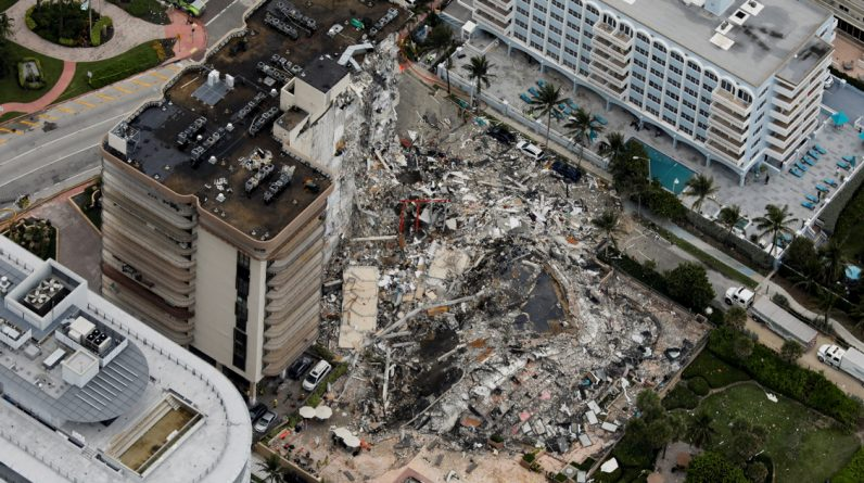 Symbol - Abroad - A fire burns beneath the rubble of a collapsed 12-story house