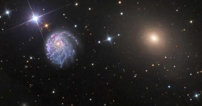 The distinctive curved spiral galaxy was discovered by the Hubble Space Telescope