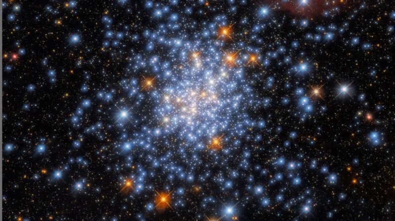 The Hubble Telescope consists of red, white, and blue stars in a bright cluster