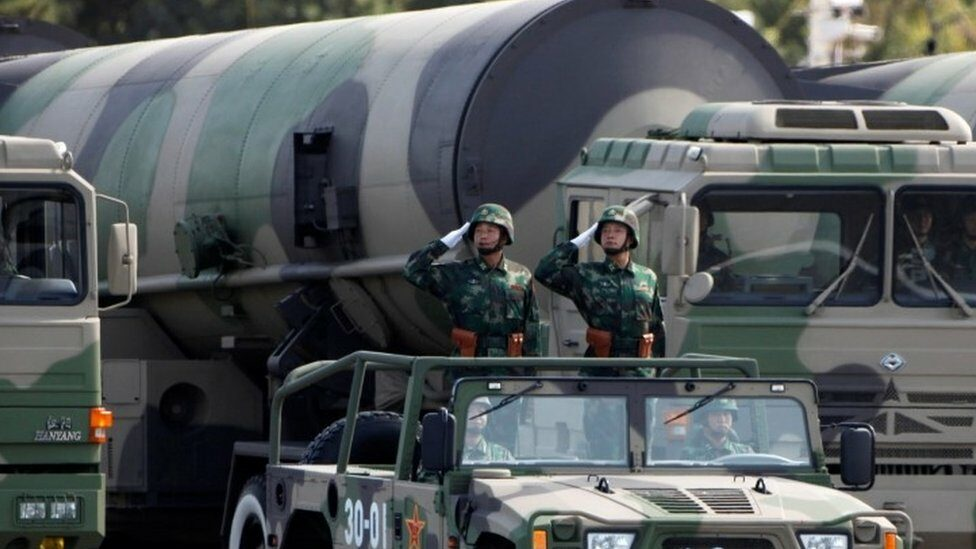 Chinese soldiers in front of nuclear weapons