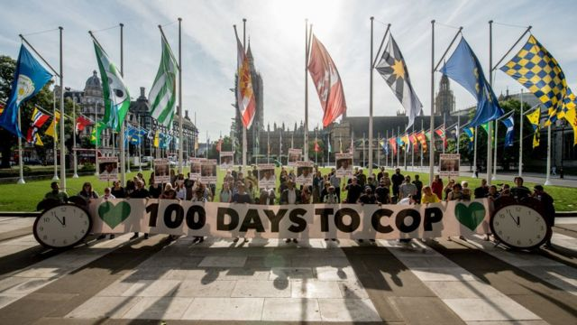 Activists put up signs in Parliament Square in London 100 days before the climate summit in Glasgow, demanding to know what action the Prime Minister will take on climate change.