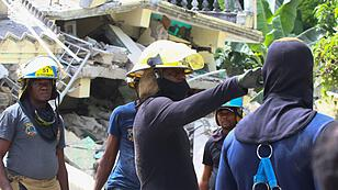 The tropical storm is affecting people in the earthquake region of Haiti