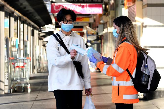 Distribution of masks on a street in Sydney on August 11.