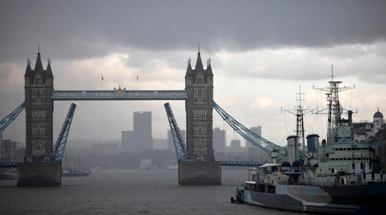 The Tower Bridge, which had been stuck for 12 hours in the elevated position, has reopened