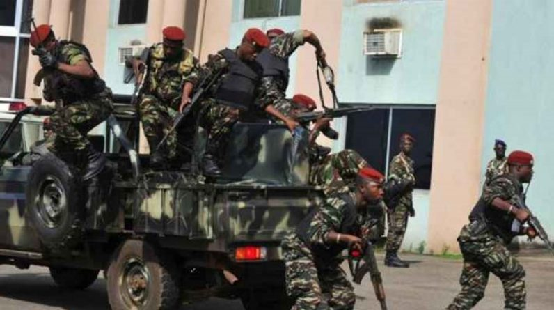 Heavy gunfire erupted in the center of Guinea's capital, and the army spread through the streets