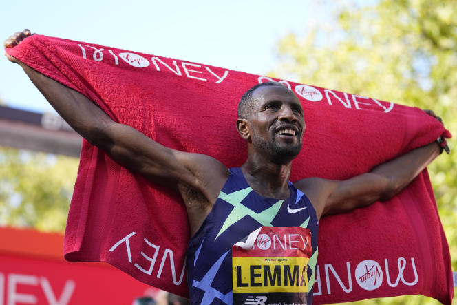 Ethiopian Cicero Lemma celebrates winning the London Marathon in England on Sunday, October 3, 2021.