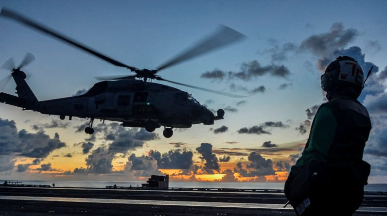Australia buys twelve attack helicopters and one fighter jet from the United States