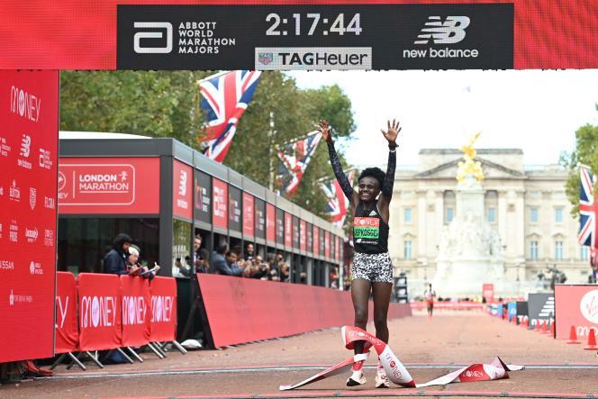 Kenya's Jocelyn Jepkowski crossed the finish line of the London Marathon in England on Sunday, October 3, 2021.